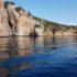 La costa di Capo Caccia e, sullo sfondo, la Torre del Bollo